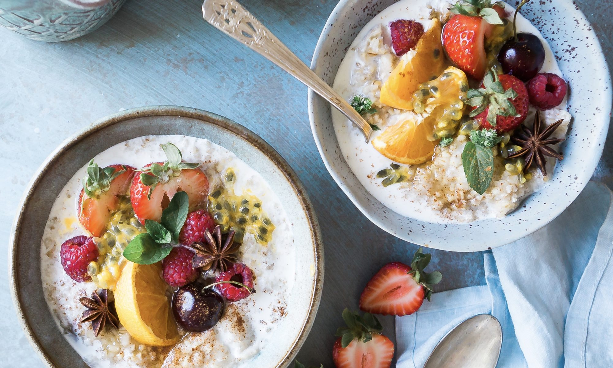 Bowls of yogurt topped with fruit demonstrate a healthy diet.